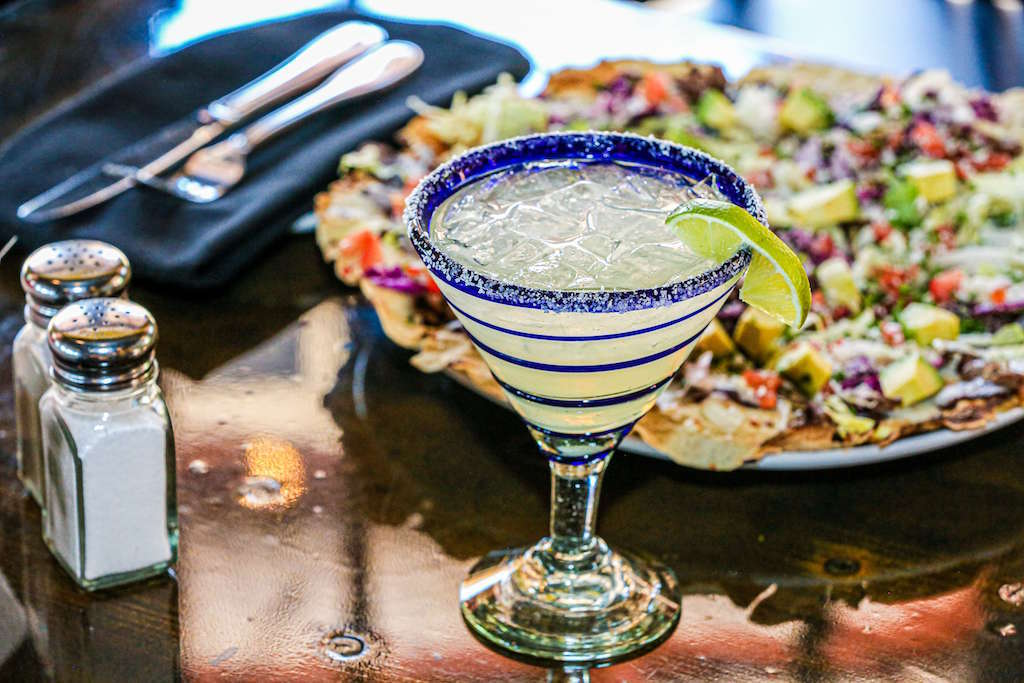 Prosecco margarita with colouful food in background